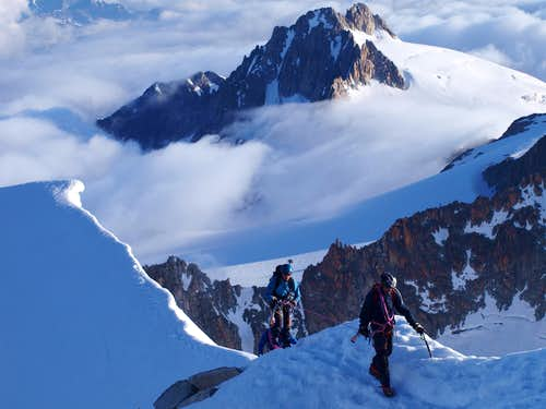 A team of three ascending the summit ridge of Aiguille d'Argentiere