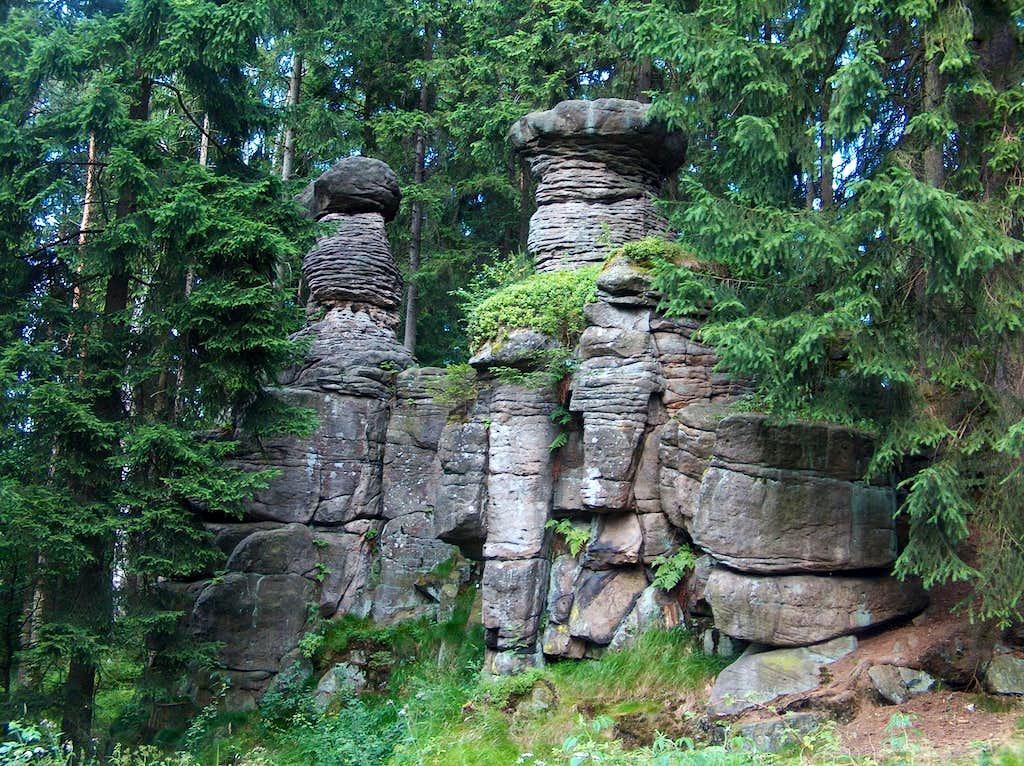 Lone rocks in Góry Stołowe, somewhere in the forest