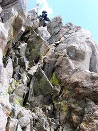 Downclimbing the crux chimney