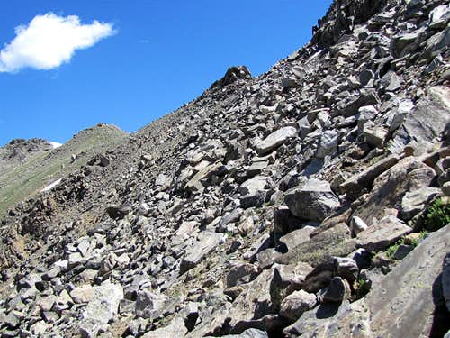 Traversing the scree slopes of Point 12925 ft