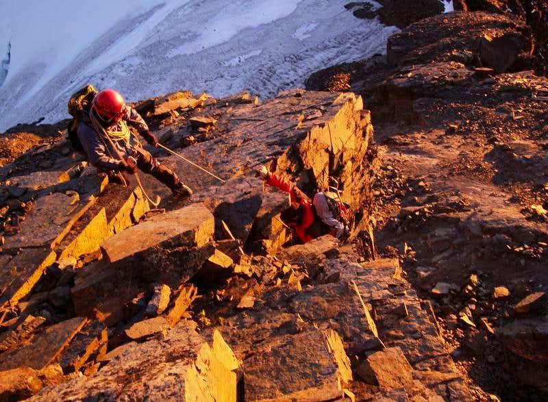 Downclimbing the summit block