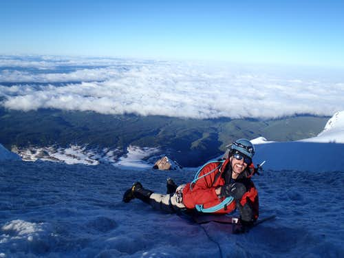 Staying low, out of the wind, on the Summit of Mt. Hood.