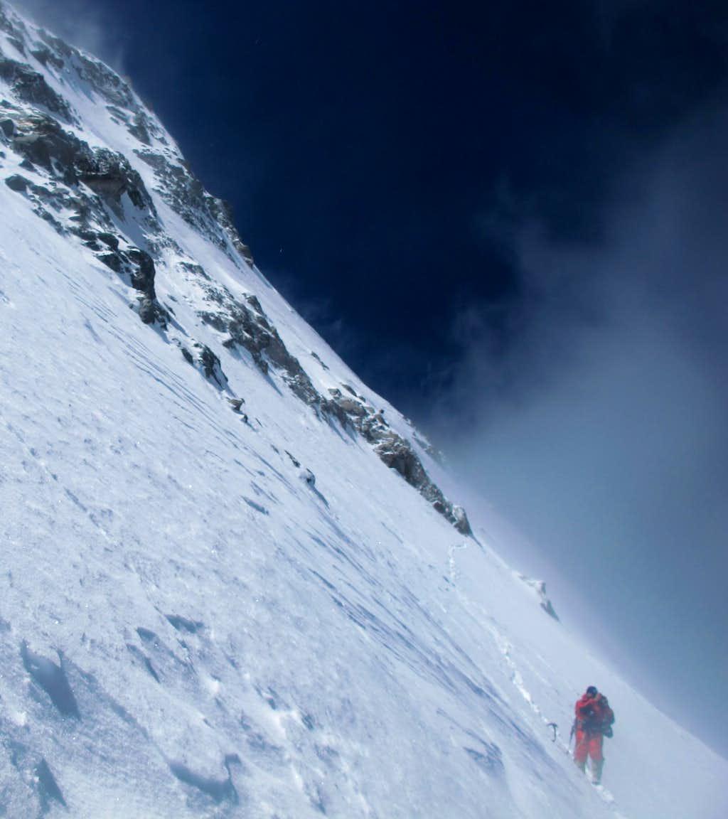 Alexey Bolotov below west ridge on descent.