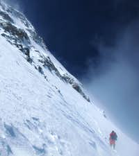 Alexey Bolotov below west ridge on descent.