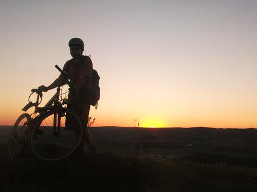 With bike at 390m at an sunset