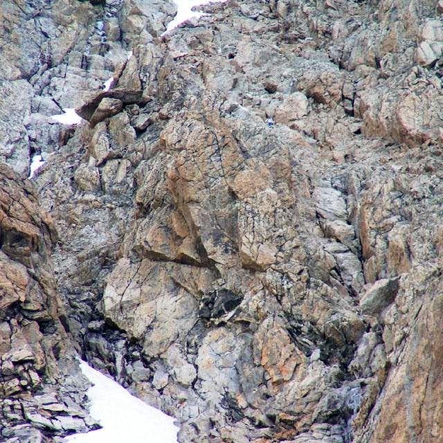 A climber downclimbing...