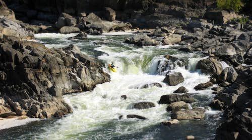Kayaker on Class 5 Rapids