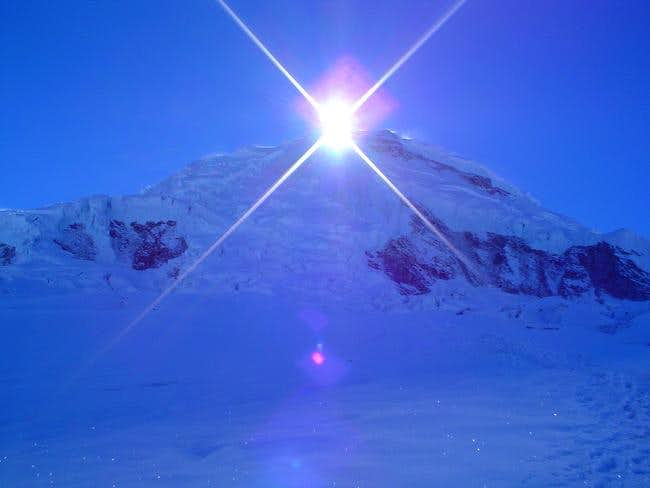 The Sun rising on the summit of...