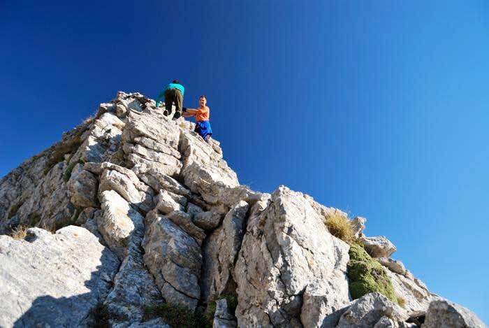 Climbing Tri Sinori small rock