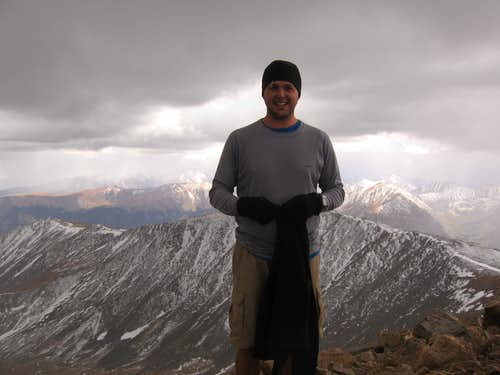 On the summit of Elbert - ominous clouds in the background