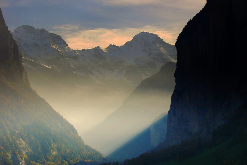 The last autumn sunbeams in the Lauterbrunnen valley, crowned by the peak of Breithorn