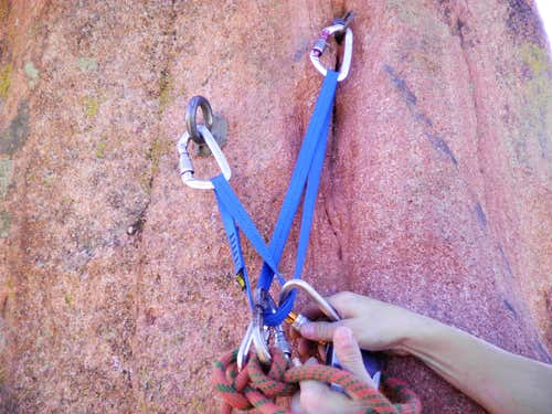 Bolted mid-way belay station