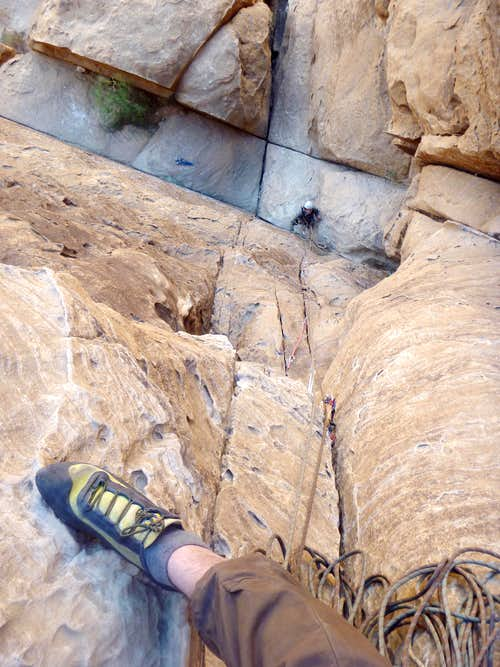 Looking down at crux of Merlin's Wand - 3rd pitch