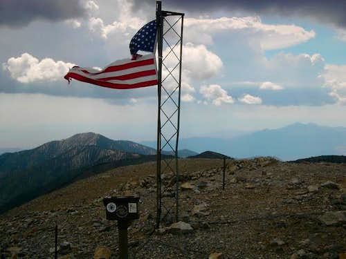 At the summit, the flag has...
