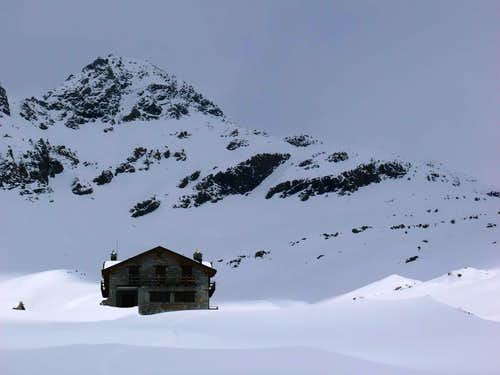 Arriving to Sogno di Berdzé Hut by snowfields in May