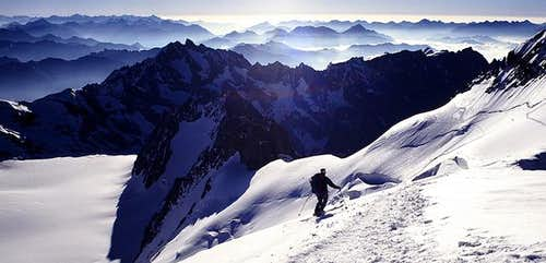 Skiing down from the Dome des...