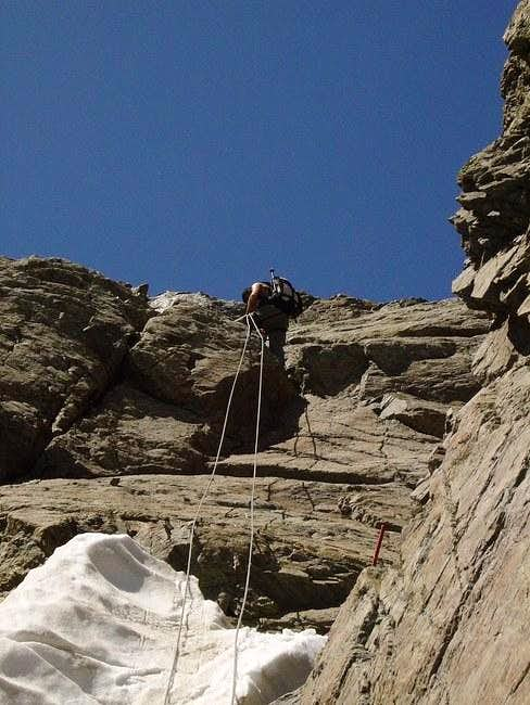 Tim Rappeling down from col...
