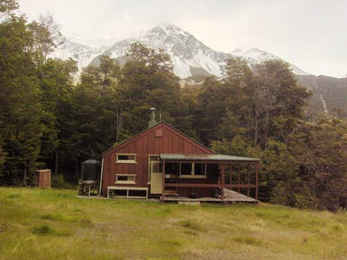 Hamilton Hut, with the mountains of the Craigieburn range in the background