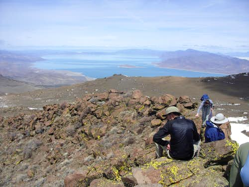 The hiking group sits atop Pah Rah Mountain looking at Pyramid Lake