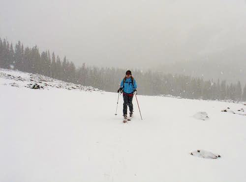Amy skinning across talus fields above Williams Lake