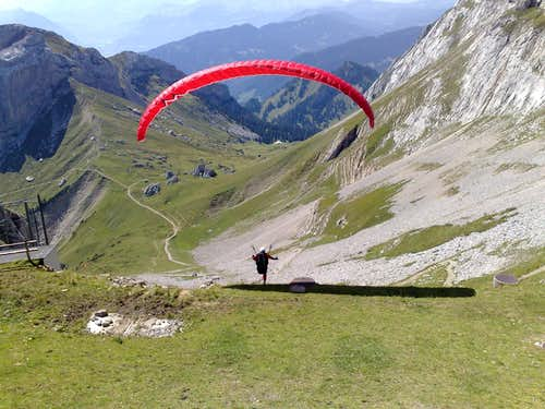 Paraglider, taking off from the
