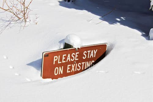 Snow buried sign