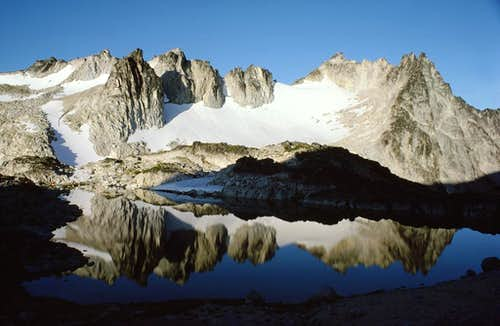 Dragontail Peak reflected in Freya Lake