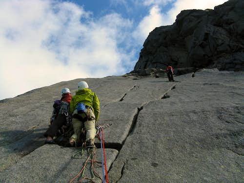 Meeting parties along the abseils in a sunny day