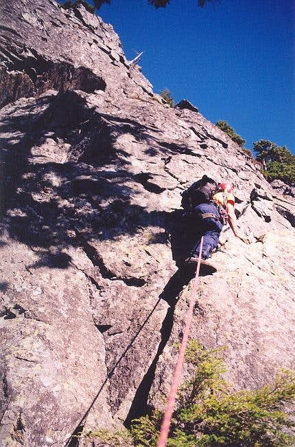 Tony begins climbing the last...