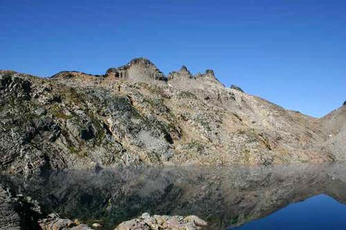 gothic peak from foggy lake,...