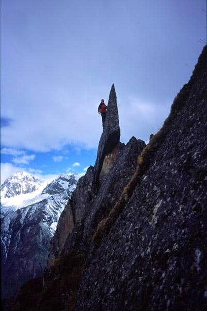 Jon Otto climbing ridge above...