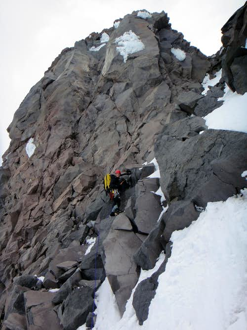 Leading cl. 3-4 terrain in the rock chimney on Ptarmigan Ridge
