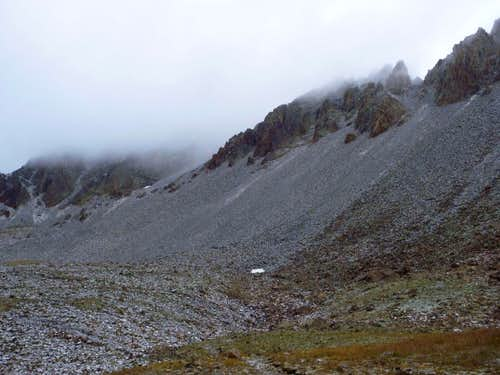 Mount Sneffels (left) and Kismet (right) in clouds as seen from Yankee Boy Trailhead