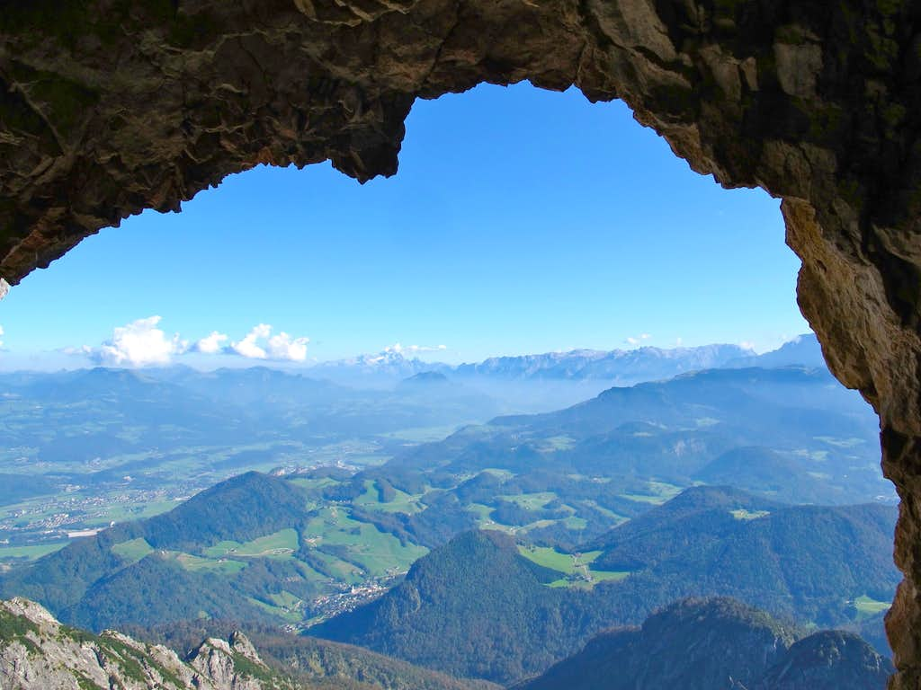 Looking through a natural rock window over the Salzach valley to Dachstein and Tennengebirge
