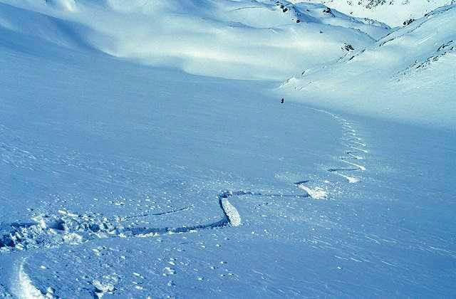 skiing down...