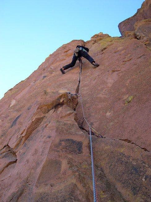 Leading the crux finger crack...