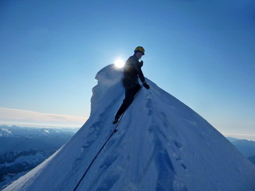 Carefully Climbing on the Summit Ridge