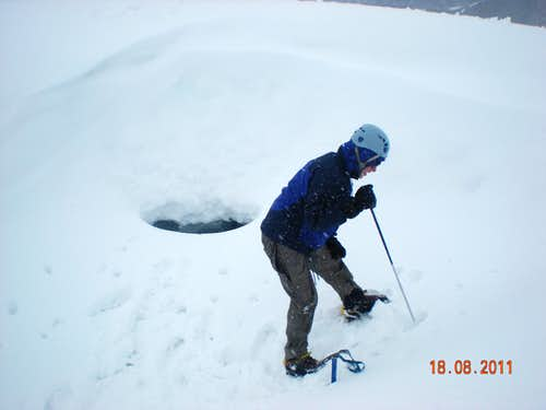 Probing filled crevasse for camp.