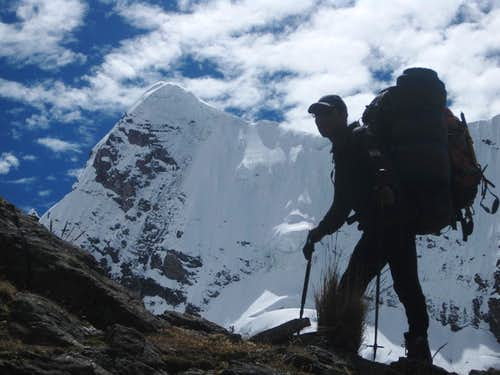 Iván carrying a huge load up to high camp