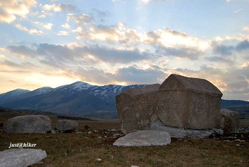 Mountain medieval tombstones under afternoon sky