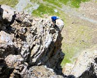 Looking for a way down. Descending the west face is NOT advisable.