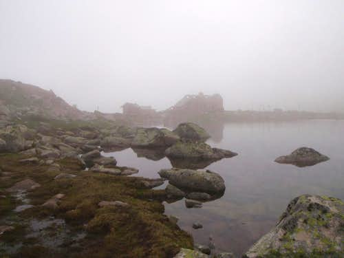 The ruined hut in fog.