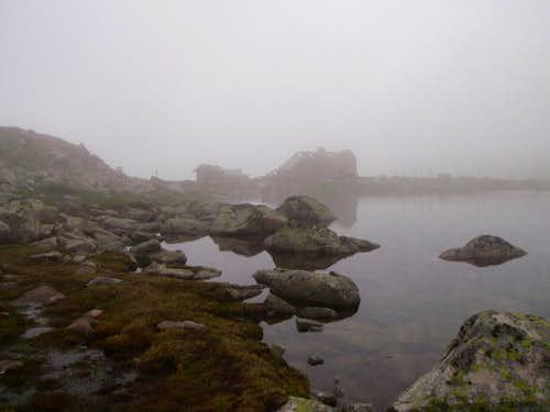 The ruined hut in fog.