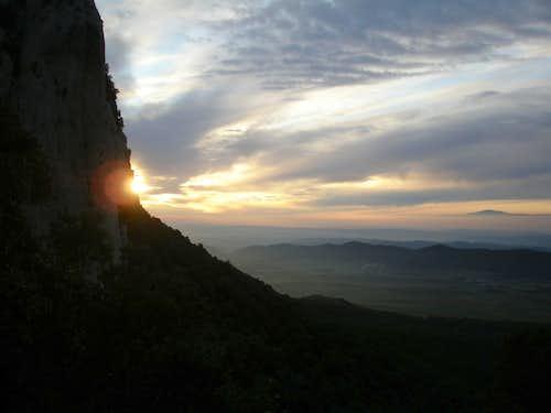 Sunrise behind Peña Gallet