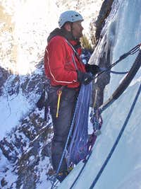 Ice climbing - Chris at the hanging belay on Cascade de Bonatchiesse