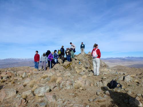 Large group standing on the summit