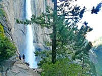 Hikers next to the falls