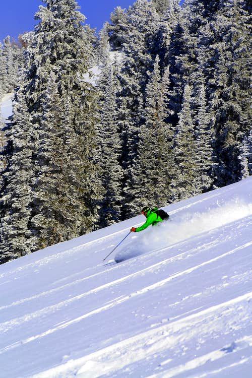 Group member skiing down Beartrap
