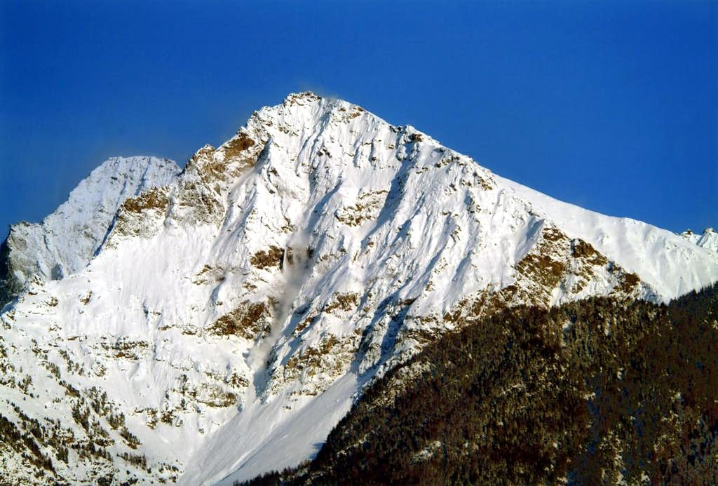 Becca of Nona <i>(3142m)</i> Snowslides on N Wall April 19th, 2004 hours 19 '30