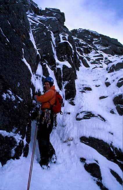 Alasdair at the belay near...